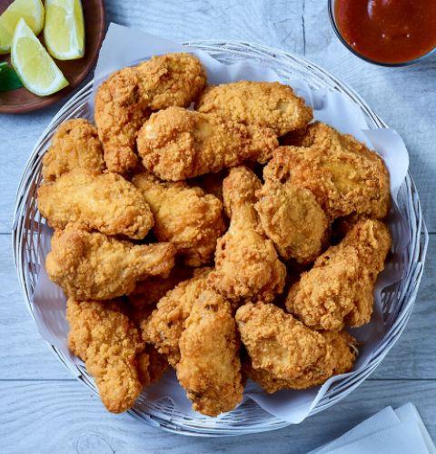 Twisters, ailes de poulet coupées et panées, entièrement cuites