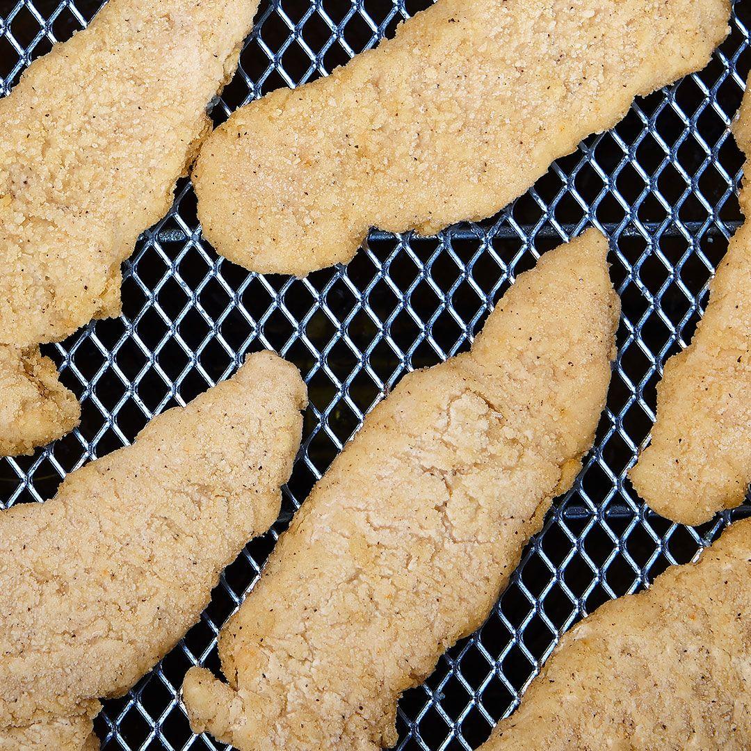 Chicken breast strips breaded uncooked (seasoned)
