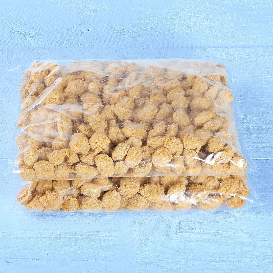 Morceaux de poulet popcorn panés, entièrement cuits